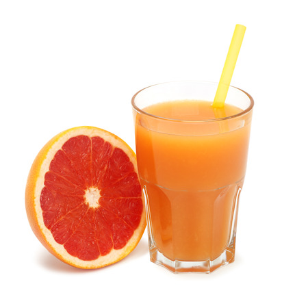 glass of freshly pressed grapefruit juice isolated