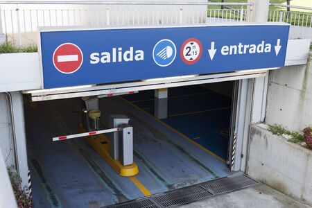 Salida, entrada sign at underground car park entrance. Exit, entry in spanish.