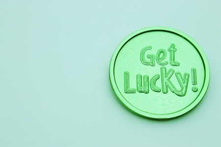 Green get lucky coin isolated on white background for St. Patricks Day