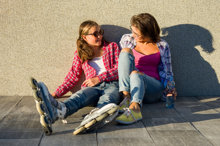 People, motherhood, family and the concept of adoption - Happy mother and daughter talking outdoors