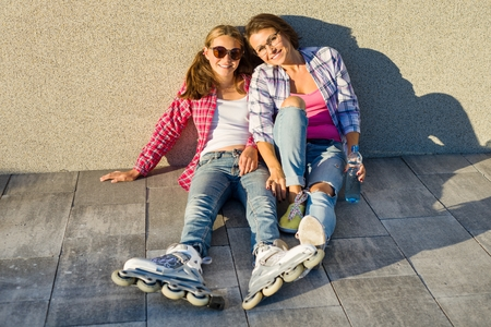 People, motherhood, family, summer. - Happy mother and daughter teen talking outdoors