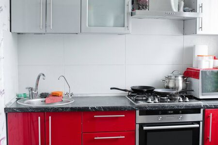 Belarus Minsk 06 12 2019Beautiful modern clean red kitchen in small apartment full shot