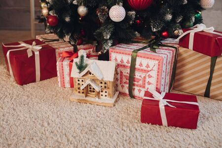 Photo for Beautiful wrapped Christmas presents under the tree. - Royalty Free Image