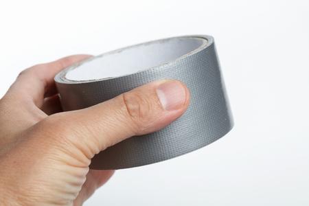 Foto de silver repair duct tape with white background - Imagen libre de derechos