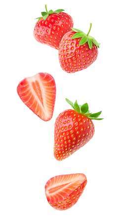 Isolated strawberries. Falling strawberry fruits whole and cut in half isolated on white background with clipping path