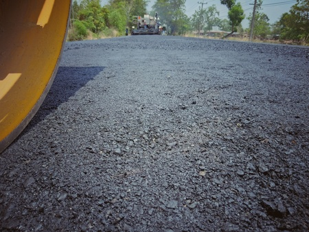 Photo for Asphalt road construction in Thailand, blurred images - Royalty Free Image