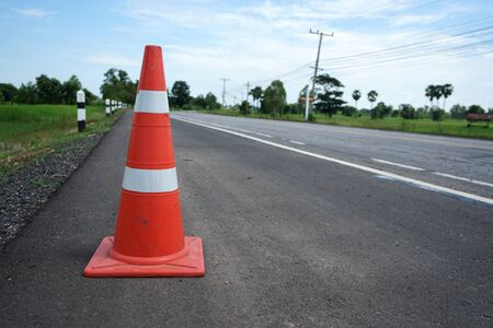 Photo pour Red rubber cone placed on the road to ensure safety - image libre de droit