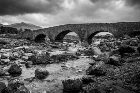 Skye Old Bridge in black and white dramatic sky