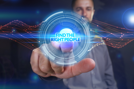 Photo pour Business, Technology, Internet and network concept. Young business man chooses the virtual screen: find the right people - image libre de droit