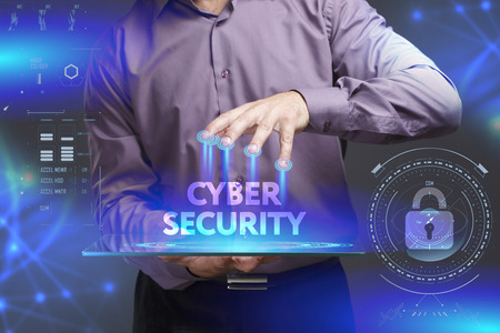 Foto de Business, Technology, Internet and network concept. Young businessman shows the word on the virtual display of the future: Cyber security - Imagen libre de derechos