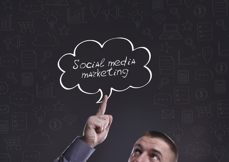 Business, Technology, Internet and marketing. Young businessman thinking about: Social media marketing