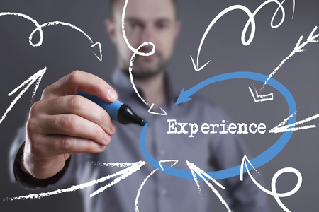 Technology, internet, business and marketing. Young business man writing word: Experience