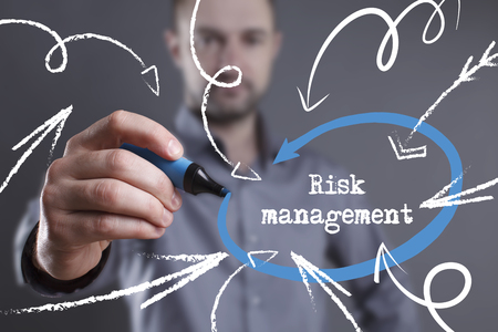 Technology, internet, business and marketing. Young business man writing word: Risk management