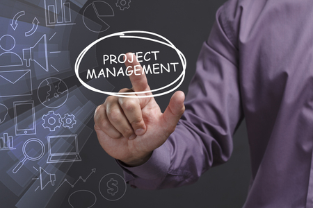 Business, Technology, Internet and network concept. Young businessman shows the word: Project management