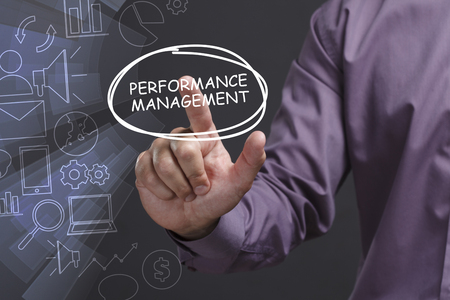 Business, Technology, Internet and network concept. Young businessman shows the word: Performance management