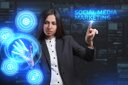 The concept of business, technology, the Internet and the network. A young entrepreneur working on a virtual screen of the future and sees the inscription: Social media marketing