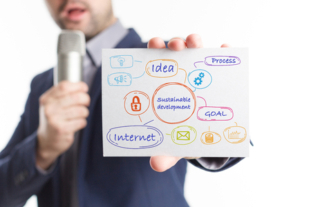The concept of business, technology, the Internet and the network. Young businessman showing inscription: Sustainable development