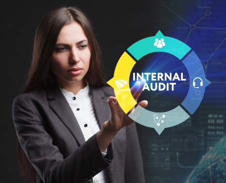 The concept of business, technology, the Internet and the network. A young entrepreneur working on a virtual screen of the future and sees the inscription: Internal audit