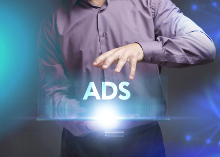 The concept of business, technology, the Internet and the network. A young entrepreneur working on a virtual screen of the future and sees the inscription: ADS