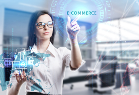 Photo pour The concept of business, technology, the Internet and the network. A young entrepreneur working on a virtual screen of the future and sees the inscription: E-commerce - image libre de droit
