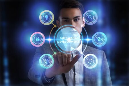 Foto de Business, Technology, Internet and network concept. Young businessman working on a virtual screen of the future and sees the inscription: - Imagen libre de derechos