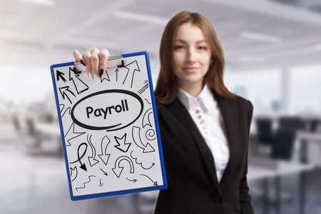 Foto de Business, technology, internet and network concept. Young businessman thinks over the steps for successful growth: Payroll - Imagen libre de derechos