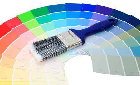 Colorful paint samples over white with paint brush