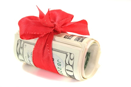 many dollar bills with a red bow on white background