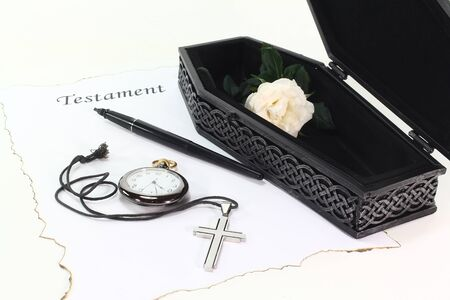 Testament with an open coffin, a white rose, clock, pen and cross