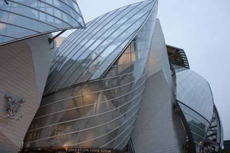 modern glass building with sails in paris