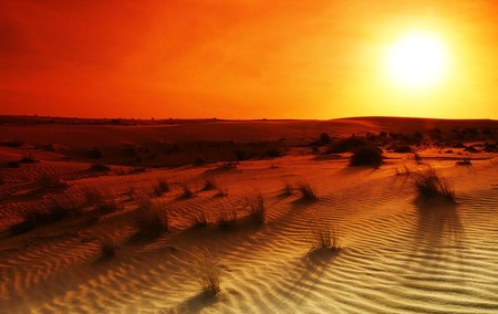 Extreme desert landscape with orange sunset