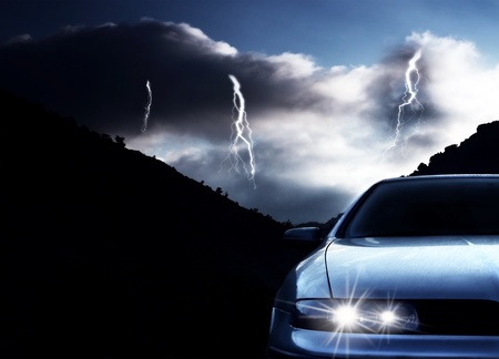 Car at night with thunderstormの写真素材