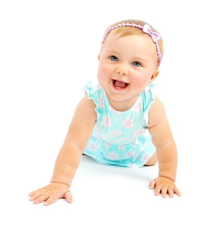 Photo for Adorable little baby girl laughing, creeping & playing in the studio, isolated on white background - Royalty Free Image