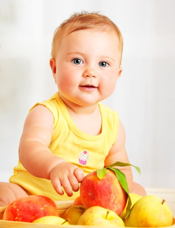 Photo for Little baby choosing fruits, closeup portrait, concept of health care & healthy child nutrition - Royalty Free Image