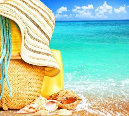 Photo pour Beach items over blue sea conceptual image of summertime vacation & holidays - image libre de droit