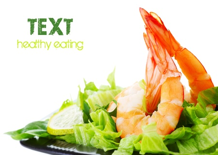 Green salad with shrimps, border isolated on white background, healthy eating concept