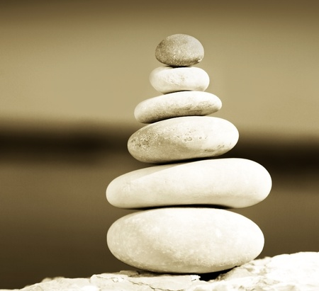 Zen balance stones sepia toned, conceptual image of relaxation & vacation