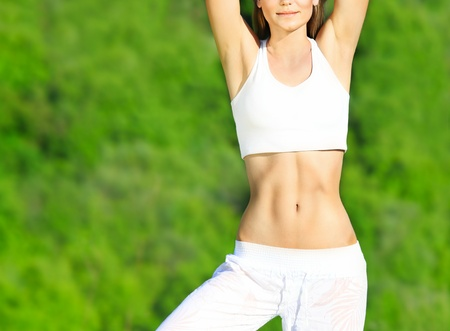 Healthy sport female body over green natural background, body care & fitness concept