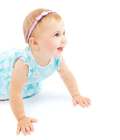 Photo for Adorable little baby girl laughing, crawling and playing at studio, isolated on white background - Royalty Free Image