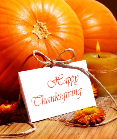Thanksgiving holiday, pumpkin still life decoration with candle on the wooden table, greeting card with text space, harvest conceptの写真素材
