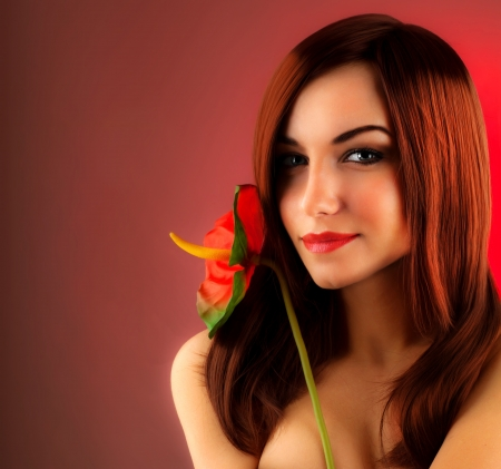Sexy red hair woman holding calla flower, glamour girl isolated over red background, stylish lady, female fashion session at indoor studio, beautiful face closeup portrait