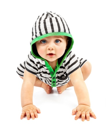 Foto de Lovely boy isolated on white background, sweet little baby wearing striped sliders, charming small kid in black & white hoodie with biggin crawling indoors, happy childhood conception - Imagen libre de derechos