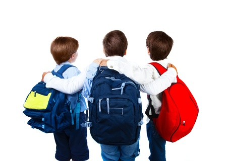 rear view of three teenager with colorful backpacks