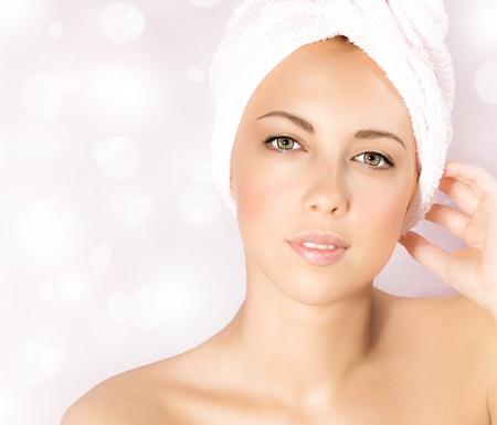 Photo pour Image of pretty woman in luxury spa salon, close up portrait of cute female isolated on pink blur glowing background, attractive young lady with perfect skin enjoying dayspa, beauty treatment   - image libre de droit