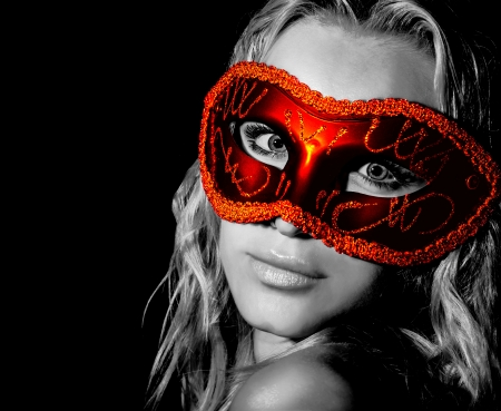 Mysterious woman wearing decorative face mask, girl at holiday party celebration, sexy female in red light isolated on black background, New Year and Christmas fashion costume, black and white