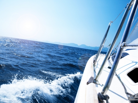 sailboat in action, speeding at open blue sea