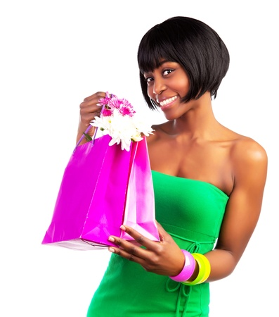 Beautiful smiling black woman with pink shopping bag isolated on white background, sale and money spending concept