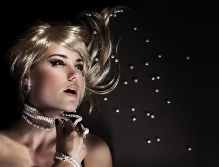 Photo pour Closeup portrait of beautiful seductive woman ripped her luxury pearl beads, desire and sexuality concept - image libre de droit