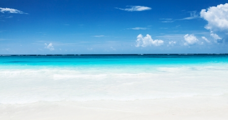Beautiful seascape clean turquoise sea white sandy coastland blue sky exotic beach luxu