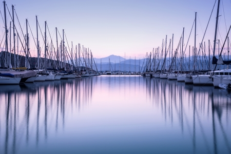 Photo for Large yacht harbor in purple sunset light, luxury summer cruise, sailboats in sunrise, leisure time, active life, vacation and holidays concept  - Royalty Free Image